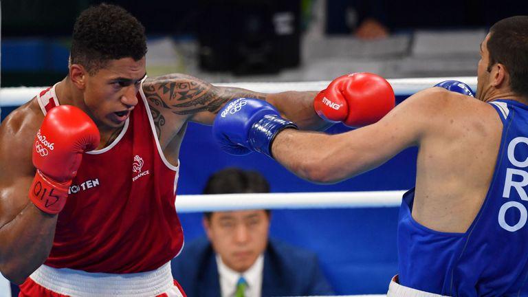 France's Tony Yoka (red) fights Croatia's Filip Hrgovic (blue)