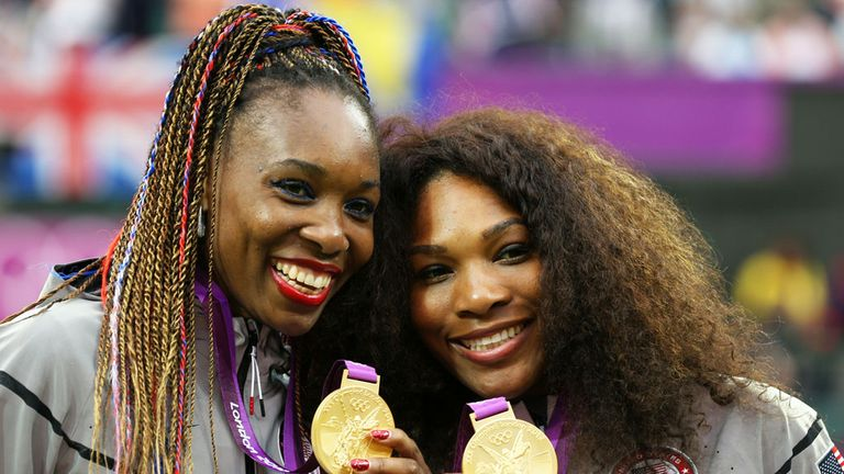 Serena with her sister Venus (L) after winning Olympic Gold in 2012