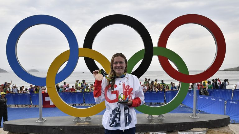 Britain's Vicky Holland celebrates with her bronze medal