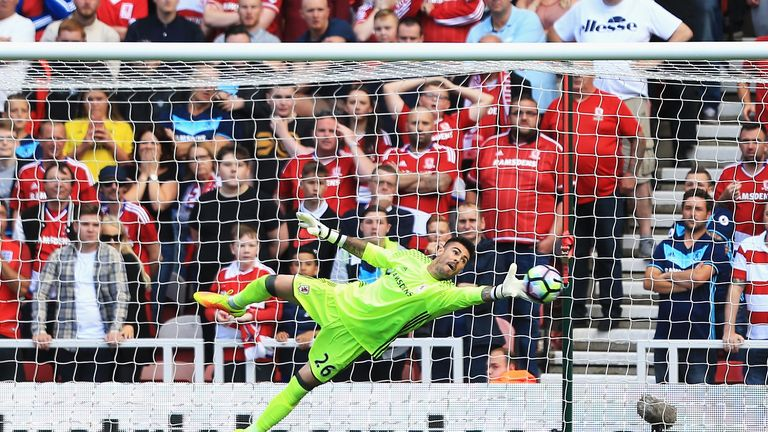MIDDLESBROUGH, ENGLAND - AUGUST 13: Victor Valdes of Middlesbrough fails to stop Xherdan Shaqiri of Stoke City shot from going in during the Premier League