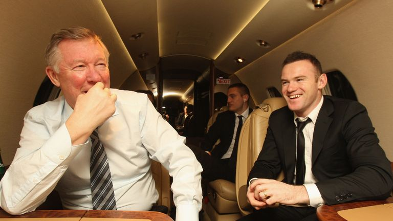 Sir Alex Ferguson and Wayne Rooney talk on the plane home after the FIFA Ballon d'Or Gala in 2011