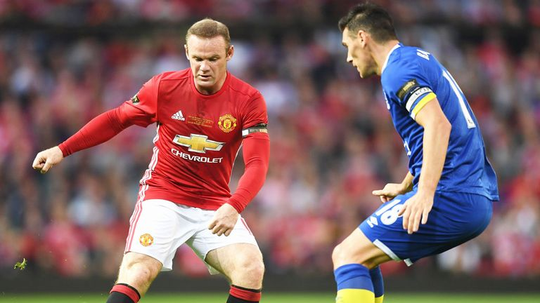 Wayne Rooney takes on Everton's Gareth Barry in the Manchester United striker's testimonial match back in August