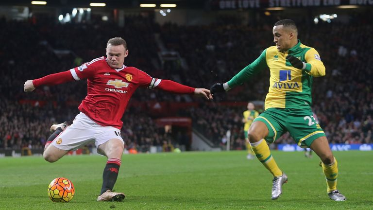Wayne Rooney  of Manchester United in action with Martin Olsson of Norwich City during the Barclays Premier League match