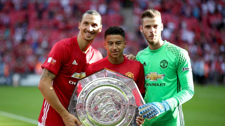 Manchester United's Zlatan Ibrahimovic, Jesse Lingard and goalkeeper David De Gea celebrate with the Community Shield