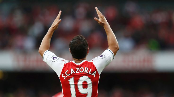 Santi Cazorla gestures during the Premier League match between Arsenal and Southampton