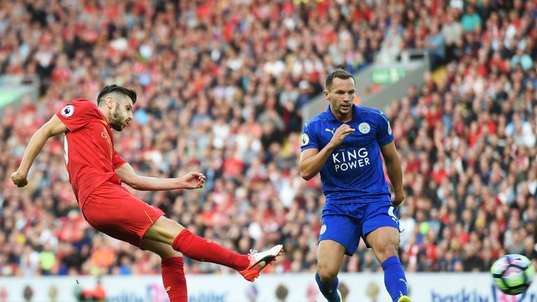 Danny Drinkwater looks on as Lallana (left) shoots and scores Liverpool's third goal