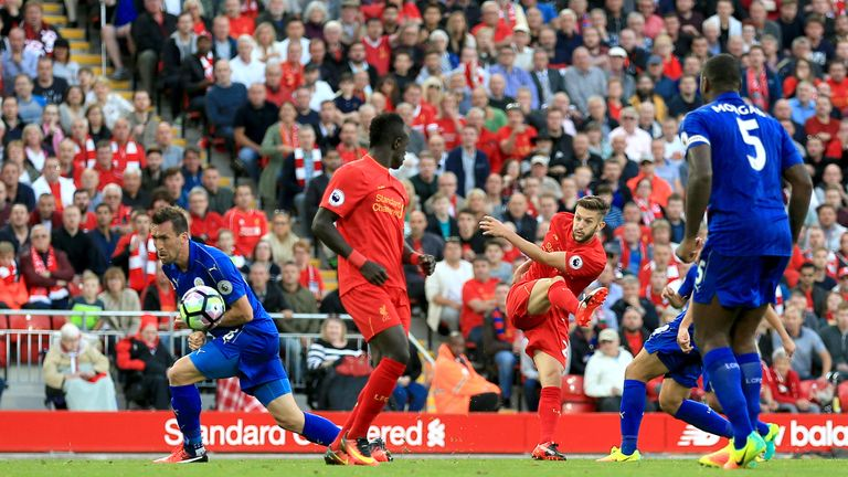 Liverpool's Adam Lallana (2ndR) scores his side's third goal of the game