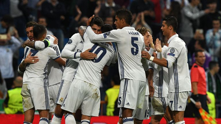 Real Madrid's forward Alvaro Morata is congratulated by his teammates after scoring during the UEFA Champions League football match Real Madrid CF vs Sport