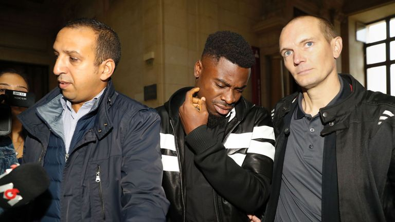 Aurier (middle) arrives at the Paris courthouse to answer the charge of elbowing a police officer