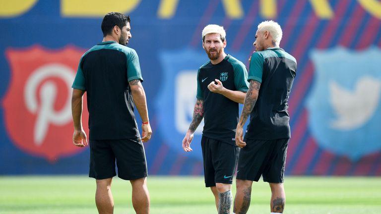 (L-R) Luis Suarez, Neymar Jr. and Lionel Messi talk amongst themselves during training