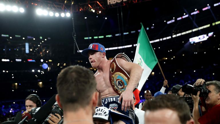 ARLINGTON, TX - SEPTEMBER 17: Canelo Alvarez celebrates after knocking out Liam Smith during the WBO Junior Middleweight World fight at AT&T Stadium on Sep