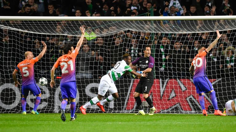 Celtic's Moussa Dembele (centre) wheels away to celebrate his goal