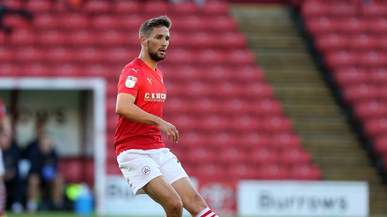 BARNSLEY, ENGLAND - AUGUST 09:  Conor Hourihane of Barnsley in action duriing during the EFL Cup match between Barnsley and Northampton Town at Oakwell Sta