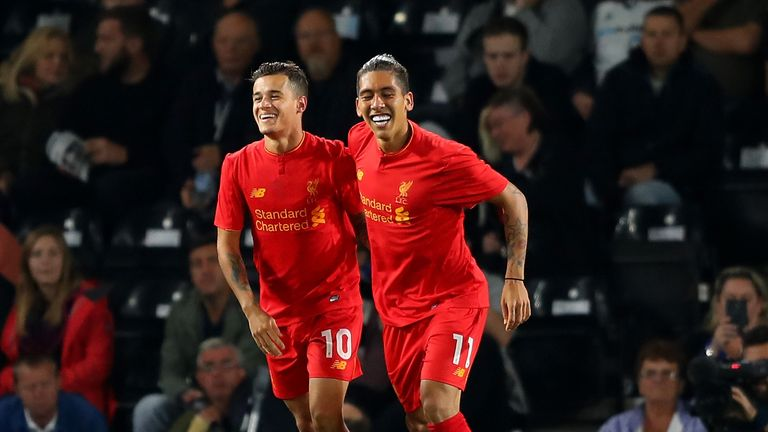 Philippe Coutinho of Liverpool celebrates scoring his team's second goal with Roberto Firmino