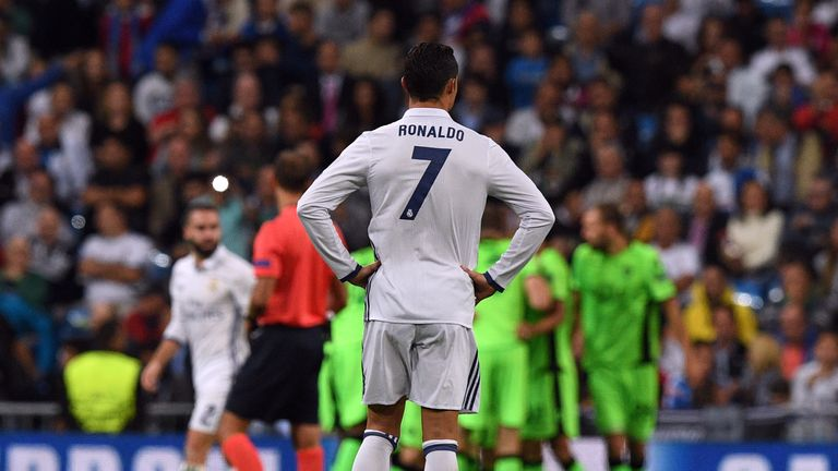 Real Madrid's Cristiano Ronaldo stands dejected as Sporting players celebrate their opening goal