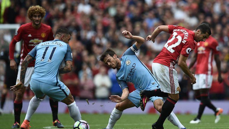 Manchester United's Armenian midfielder Henrikh Mkhitaryan (R) vies with Manchester City's Serbian defender Aleksandar Kolarov
