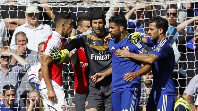 Arsenal's Brazilian defender Gabriel (L) and Chelsea's Brazilian-born Spanish striker Diego Costa (2nd R) are separated by Arsenal's Czech goalkeeper Petr