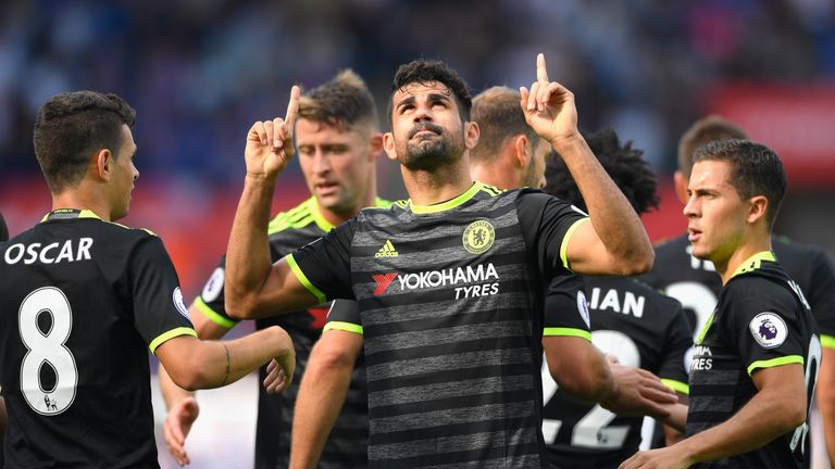 Diego Costa of Chelsea (C) celebrates with team-mates as he scores their first goal during the Premier League match at Swansea
