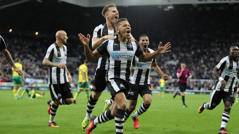 Newcastle's Dwight Gayle (centre) celebrates after scoring the late winner