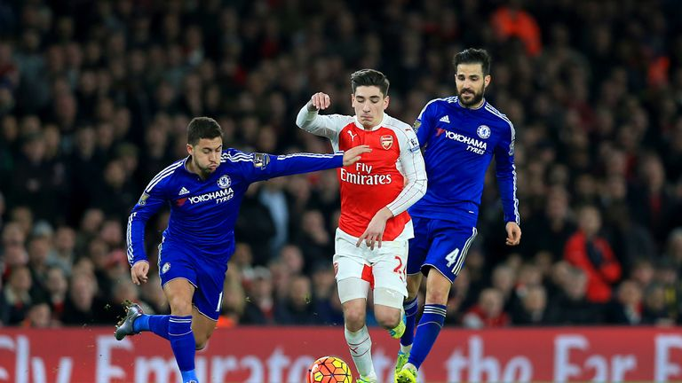 Chelsea's Eden Hazard (left) and Cesc Fabregas (right) battle for the ball with Arsenal's Hector Bellerin