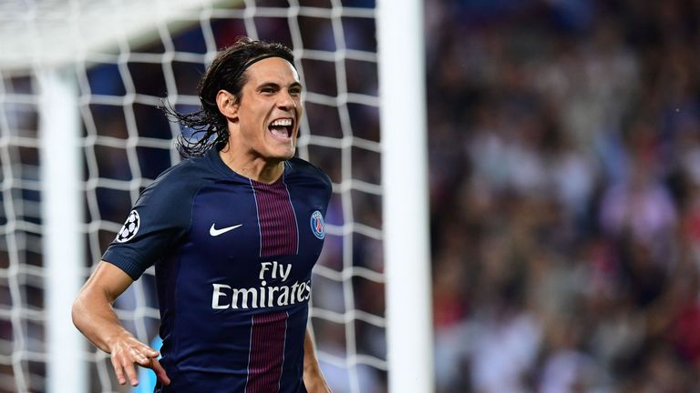 Paris Saint-Germain's Uruguayan forward Edinson Cavani celebrates after scoring against Arsenal