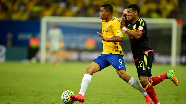 Gabriel Jesus looks to escape the attention of a Colombian defender
