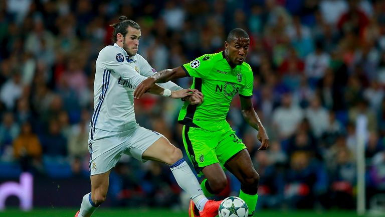 MADRID, SPAIN - SEPTEMBER 14: Gareth Bale (L) of Real Madrid CF competes for the ball with Marvin Zeegelaar (R) of Sporting CP during the UEFA Champions Le
