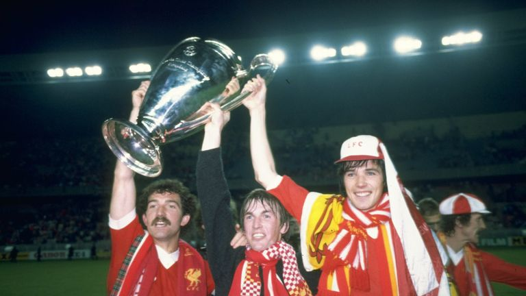 Graeme Souness (L), Kenny Dalglish (C) and Alan Hansen (R) hold up the European Cup after beating Real Madrid in the 1981 European Cup final.