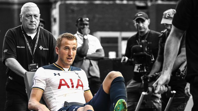 Harry Kane of Tottenham Hotspur is put onto a stretcher after coming off injured during the Premier League match against Sunderland