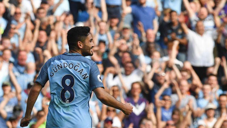 Ilkay Gundogan celebrates scoring Man City's fourth goal against Bournemouth