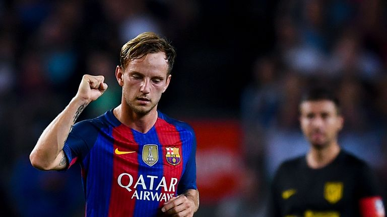 Ivan Rakitic celebrates the opening goal against Atletico Madrid