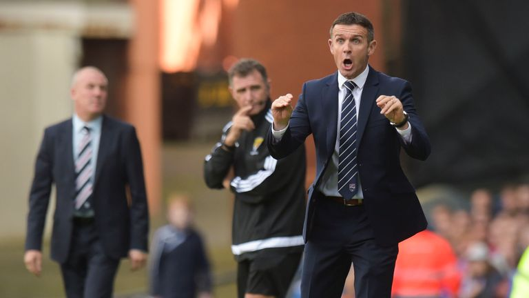 Ross County manager Jim McIntyre (right) urges on his side at Ibrox in September