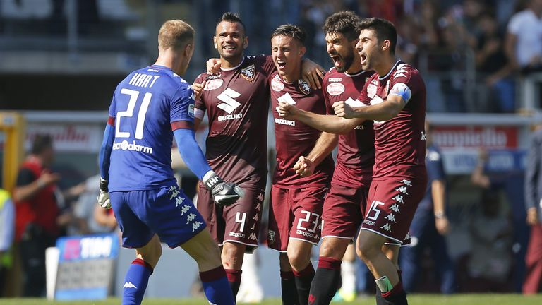 Torino's players celebrate at the end of the match