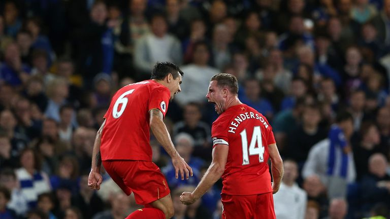 Henderson (right) celebrates scoring his side's second goal
