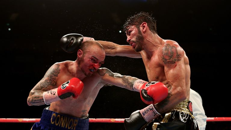 LONDON, ENGLAND - MAY 30:  Kevin Mitchell of England and Jorge Linares of Venezuela exchange blows during their WBC World Lightweight Championship bout at