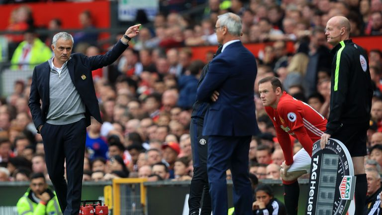 Manchester United manager Jose Mourinho points as Wayne Rooney waits to come on
