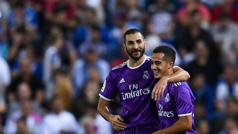 Karim Benzema (L) celebrates with his team mate Lucas Vazquez of Real Madrid after scoring his team's second goal