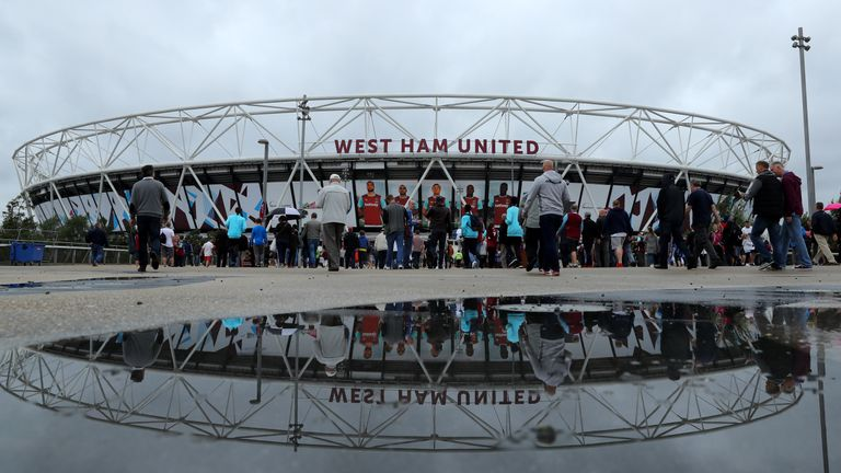 LONDON, ENGLAND - SEPTEMBER 10:  Spectators walk to the stadium before the Premier League match between West Ham United and Watford at the Olympic Stadium