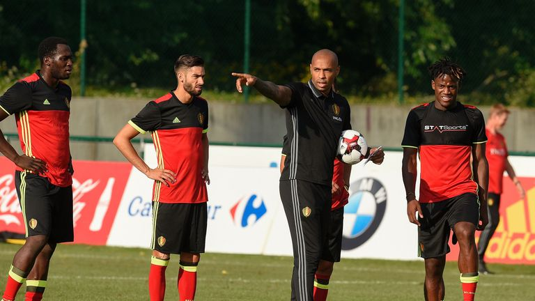 Belgium's national team assistant coach Thierry Henry (2nd R) gestures as he talks to Belgium's forward Michy Batshuayi (R) during a training session, thre
