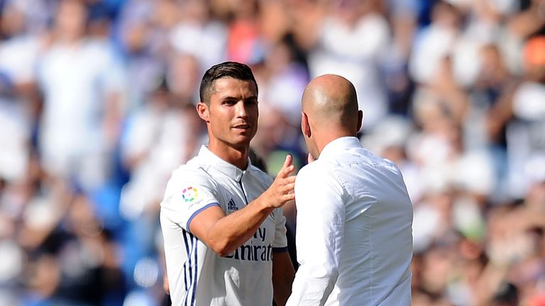 Cristiano Ronaldo shakes hands with Real manager Zinedine Zidane after being substituted against Osasuna