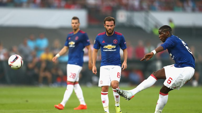 Pogba (right) tries his luck with a 30-yard free-kick