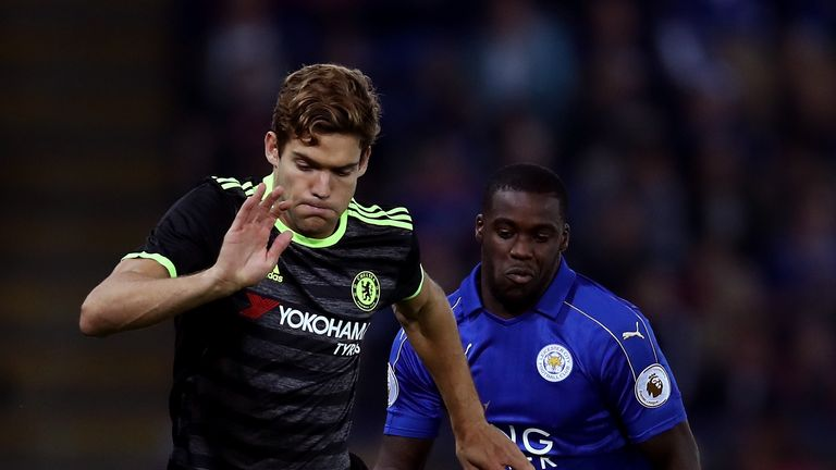 Marcos Alonso of Chelsea is closed down by Jeffrey Schlupp of Leicester City during the EFL Cup Third Round match at the King Power Stadium
