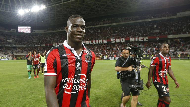 Nice forward Mario Balotelli is all smiles after his debut