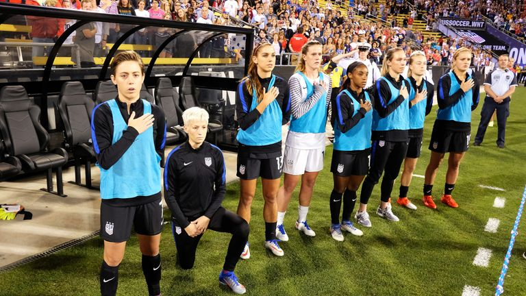 Megan Rapinoe (second left) knelt before a USWNT game against Thailand