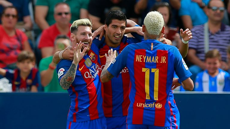 Lionel Messi (L) celebrates scoring their opening goal with teammate Luis Suarez (2ndL) and Neymar