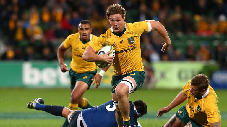 Michael Hooper  breaks from a tackle as he runs in a try