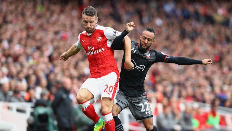 Shkodran Mustafi vies with Southampton's Nathan Redmond at the Emirates