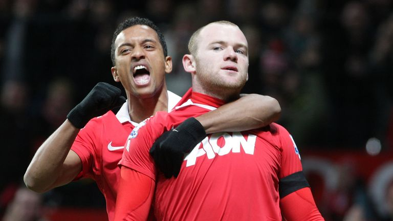 Nani and Wayne Rooney at Old Trafford on February 1, 2011 in Manchester, England.