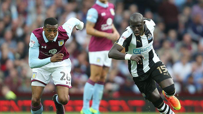 Aston Villa's Albert Adomah and Newcastle United's Mohamed Diame (right) battle for the ball