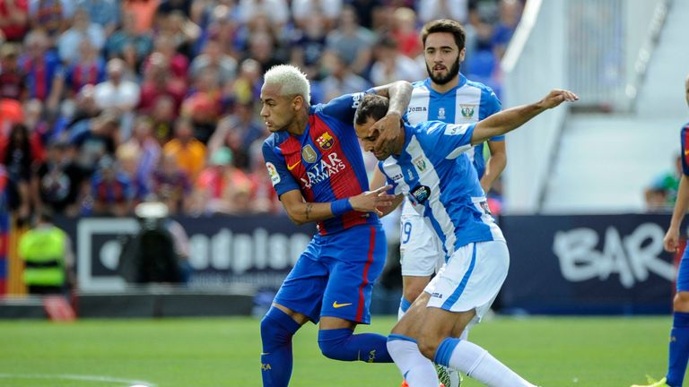 Barcelona's Neymar vies with Leganes defender Victor Diaz during the La Liga clash